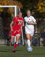 Marist College forward/midfielder Amanda Epstein (24) brings the ball forward as Boston College midfielder Julia Bouchelle (12) closes. Boston College defeated Marist College, 6-1, in NCAA tournament play at Newton Campus Field, November 13, 2011.
