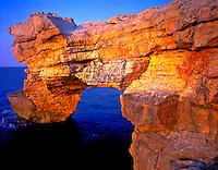 Sea Arch on Crete Coast, Sea of Crete, Greece, Aegan Sea,  Limestone cliffs along North Coast,  May, Evening