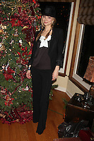 LOS ANGELES - DEC 17:  Tamara Braun at the 2011 Tom / Achor Annual Christmas Party at Private Home on December 17, 2011 in Glendale, CA