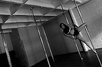 Carolina Echavarria, a young Colombian pole dancer, shows off her balance ability during a pole dance training session in Academia Pin Up in Medellín, Colombia, 25 February 2016. Pole dance, a performance combining sport with art and merging dance with acrobatics on a vertical pole, has reached wide popularity in Latin America in the last decade. With dance and physical attraction being a natural way of expression for many Latinas, thousands of women take pole dancing classes in gyms and dance studios, as a form of fitness and social entertainment.