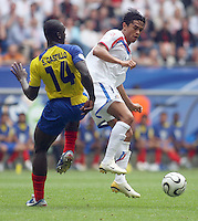 Ecuador's Segundo Castillo (14) and Costa Rica's Walter Centeno (right) colide. Ecuador defeated Costa Rica 3-0 in their FIFA World Cup Group A match at FIFA World Cup Stadium, Hamburg, Germany, June 15, 2006.