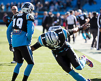 The Carolina Panthers played the San Francisco 49ers at Bank of America Stadium in Charlotte, NC in the NFC divisional playoffs on January 12, 2014.  The 49ers won 23-10.  Carolina Panthers quarterback Cam Newton (1), Carolina Panthers wide receiver Ted Ginn (19)