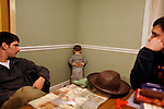 My husband, left, punishes our older son, then two and a half, by having him stand in the corner. My husband's twin brother is at right.