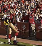 San Francisco 49ers wide receiver Terrell Owens (81) celebrates with crowd over his touchdown on Sunday, October 27, 2002, in San Francisco, California. The 49ers defeated the Cardinals 38-28.