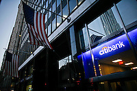 U.S. flags hold up from a building next to a Citibank branch in New York. 16/10/2012. The Board of Directors of Citigroup announced that Vikram Pandit has stepped down as the Company's CEO and it has unanimously elected Michael Corbat as new CEO and a director of the Board. Photo by Eduardo Munoz Alvarez / VIEWpress.