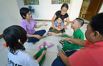 A therapy group at Kaisahan ng Magulang at Anak na Maykapansanan (Kaisaka), a mothers' group in the Malate neighborhood of Manila that carries out community based rehabilitation with families which have members with disabilities.