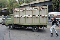 "Banksy enthusiasts flock to the trendy Meatpacking District in New York on Friday, October 11, 2013 to see the eleventh installment of Banksy's art, ""The Sirens of the Lambs"". This particular sculptural piece consists of a slaughterhouse truck filled with bleating plush animals, controlled by puppeteers, which were driven around by a driver, who remained in character. The elusive street artist is creating works around the city each day, during the month of October accompanied by a satirical recorded message parodying a museum tour which you can get by calling the number 1-800-656-4271 followed by  # and the number of artwork.  (© Richard B. Levine)"