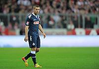 FUSSBALL   1. BUNDESLIGA  SAISON 2011/2012   17. Spieltag   16.12.2011 FC Bayern Muenchen - 1. FC Koeln        Lukas Podolski (1. FC Koeln)  nachdenklich