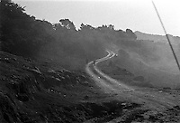 IPLM0049 , South Africa, Funduzi. People walking in the dust of a passing vehicle.