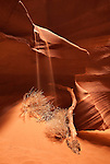 Sand trickles over a Navajo Sandstone ledge in Upper Antelope Canyon near Page