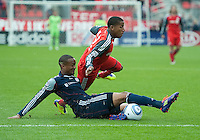 22 October 2011: Toronto FC forward Joao Plata #7 and New England Revolution defender Darrius Barnes #25 in action during a game between the New England Revolution and Toronto FC at BMO Field in Toronto..The game ended in a 2-2 draw.
