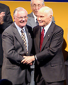 Space pioneers Neil A. Armstrong and John H. Glenn share an embrace as they are introduced during the dedication of the National Air and Space Museum's Steven F. Udvar-Hazy Center in Chantilly, Virginia on December 11, 2003.  Armstrong flew the X-15 rocket plane, was the mission commander for Gemini 8, and on July 20, 1969, as commander of the Apollo 11 mission, ws the first human to walk on the Moon.  Glenn became the first American to orbit the Earth on February 20, 1962.  Subsequently, he served as a United States senator from Ohio and was a mission specialist on the space shuttle STS-95 mission in October, 1998..Credit: Ron Sachs / CNP