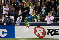 Obafemi Martins of the Seattle Sounders FC celebrates scoring a goal with a back flip during play against Real Salt Lake at CenturyLink Field in Seattle Friday September 13, 2013. The Sounders won the match 2-0.