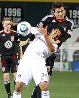 Mark Burch (4) of D.C. United  presses onto Miguel Lopez (25) of the Los Angeles Galaxy during an MLS match at RFK Stadium, on April 9 2011, in Washington D.C.The game ended in a 1-1 tie.