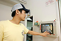 NAGOYA - SEPTEMBER 3, 2009: Aisei, an industrial robot maker in Nagoya opens Fa-men, a noodle shop where two robot arms work as hi-tech chefs that feed and entertain customers. Jun Yabe, the manager of the noodle shop order the ramen chosen by a customer. (Photo Laurent Benchana/Nippon News)