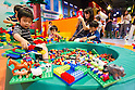 June 14, 2012, Tokyo, Japan - Kids play with various LEGO toys during a press preview event at the LEGOLAND Discovery Center Tokyo. The LEGOLAND Discovery Center contains over 3 million LEGO bricks in-house, a 4D movie theater, iconic city land marks of Tokyo all made of LEGO, and a interactive laser ride. The discovery center will open to the general public on June 15, 2012. (Photo by Christopher Jue/AFLO)