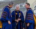 May 18, 2014; University of Notre Dame president Rev. John Jenkins, C.S.C., left, and Notre Dame Board of Trustees chairman Richard Notebaert, right, present an honorary degree to Sally Mason at the 2014 Commencement ceremony in Notre Dame Stadium.<br /> <br /> Photo by Matt Cashore/University of Notre Dame