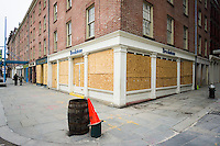 The empty South Street Seaport historic district with boarded up stores is seen on Sunday, January 13, 2013 when it is usually teeming with tourists. The area has been hit hard by Superstorm Sandy and the businesses that have managed to open, several restaurants and Pier 17, are struggling as visitors still think the area is closed and many office buildings in the area are still unfit for use. (© Richard B. Levine)