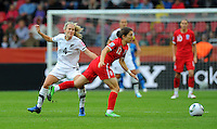 Katie Hoyle (l) of team New Zealand and Karen Carney of team England during the FIFA Women's World Cup at the FIFA Stadium in Dresden, Germany on July 1st, 2011.