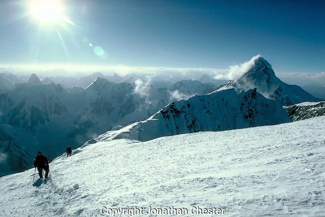 Climbers on the summit ridge of Broad Peak, The 800 meter mountain next to K2 the second highest mountain in the world. Altitude 8047 m