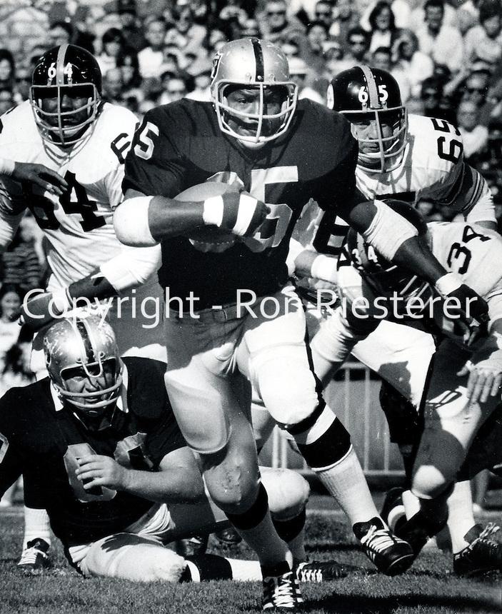Raider back Hewritt Dixon runs for 1st down. 1969.copyright Ron Riesterer 1969