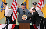 ASBURY PARK, NJ - (May 28, 2013) - A White House staffer pulls the Presidential seal off the podium as Asbury Park police officers joke on stage just after President Barack Obama delivered a speech on the boardwalk with New Jersey Gov. Chris Christie outside Convention Hall.