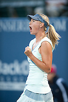 Maria Sharapova celebrates after winning a point as she defeats Zheng Jie 6-4, 7-5, in the opening round of the Bank of the West Classic, in Stanford, California, July 27, 2010.