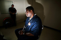 Maurice Reed during an interview at the Orange County jail, Orange County Correctional Corporal Jim Coleman stands guard. His life sentence was recently reduced, Orlando, Tuesday, September 9, 2008. (Roberto Gonzalez/Orlando Sentinel)