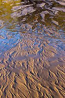 Nature's abstract creation formed by a creek running into Lake Michigan on the beach at Holland, MI.