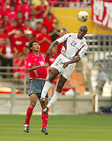 Eddie Pope jumps for a header. The USA tied South Korea, 1-1, during the FIFA World Cup 2002 in Daegu, Korea.