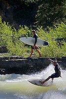 River surfers surfing Lunch Counter Rapid on the Snake River in Jackson Hole, Wyoming