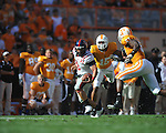Ole Miss quarterback Jeremiah Masoli (8) runs as Tennessee defensive back Janzen Jackson (15) defends in a college football game at Neyland Stadium in Knoxville, Tenn. on Saturday, November 13, 2010. Tennessee won 52-14.