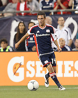New England Revolution forward Diego Fagundez (14) brings the ball forward. In a Major League Soccer (MLS) match, the New England Revolution defeated Vancouver Whitecaps FC, 4-1, at Gillette Stadium on May 12, 2012.