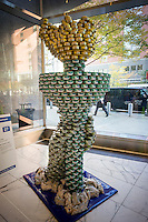 The StaTUNA of Liberty by Gilsanz Murray Steficek LLP in the 22nd annual Canstruction Design Competition in New York, seen on Monday, November 10, 2014, on display in Brookfield Place in Lower Manhattan. They sculpture is comprised of 1848 cans and will feed 481 New Yorkers. Architecture and design firm participate to design and build giant structures made from cans of food.  The cans are donated to City Harvest at the close of the exhibit. Over 100,000 cans of food were collected and will be used to feed the needy at 500 soup kitchens and food pantries. (© Richard B. Levine)