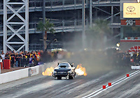 Oct 29, 2016; Las Vegas, NV, USA; NHRA funny car driver Jon Capps does a wheelstand during qualifying for the Toyota Nationals at The Strip at Las Vegas Motor Speedway. Mandatory Credit: Mark J. Rebilas-USA TODAY Sports