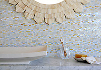 Smalti, a hand cut glass mosaic shown in Agate, Pearl, Quartz, Opal, is part of the Erin Adams Collection for New Ravenna Mosaics.