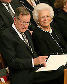 Former United States President George H.W. Bush and former first lady Barbara Bush attend the State Funeral for former United States President Gerald R. Ford at the Washington National Cathedral, in Washington, D.C. on Tuesday, January 2, 2007..Credit: Ron Sachs / CNP.[NOTE: No New York Metro or other Newspapers within a 75 mile radius of New York City].