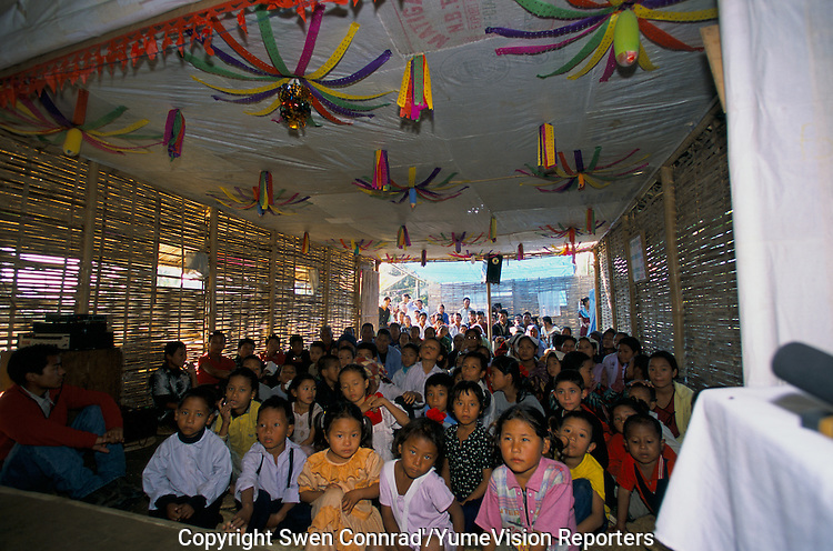 Under UNHCR protection, the life of 135000 Bhutanese refugees in one of the 7 camp near Damak, Nepal. Thousand of Christians refugees are celebrating Christmas day in a camps with pray, song and food..-The full text reportage is available on request in Word format