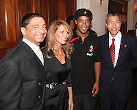 Ronaldinho of AC Milan poses with Will Chang and friends of DC United at a reception for AC Milan at DAR Constitution Hall in Washington DC on May 24 2010.