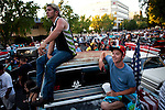 "Thomas Jackson, left, and Justin Demerse, right, watch classic cars cruise the streets of Modesto, California during the American Graffiti Parade, June 7, 2013. Modesto is celebrating the 40th anniversary of the film ""American Graffiti"", with a parade headed up by native son, filmmaker George Lucas."