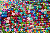 Long Island, New York. West Hampton Bead Shop - strings of colored beads.