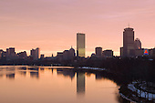 Boston dawn skyline reflected in Charles River. John Hancock tower, Prudential Center,.111 Huntington Avenue and the Citgo neon sign in view. Massachusetts USA