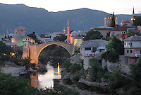 Stari Most or Old Bridge, a 16th century Ottoman bridge across the Neretva river, and the Koski Mehmed Pasha Mosque, in Mostar, Bosnia and Herzegovina. The bridge was destroyed in the 1990s Yugoslavian war and has been rebuilt. The town is named after the mostari or bridge keepers of the Old Bridge. Mostar developed in the 15th and 16th centuries as an Ottoman frontier town and is listed as a UNESCO World Heritage Site. Picture by Manuel Cohen