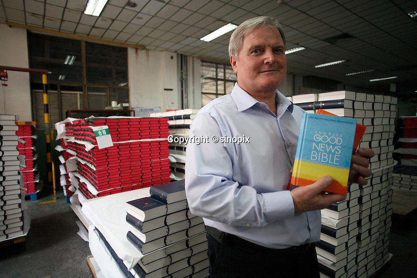 Peter Dean, UBS consultant and factory manager holding copies of the Collins Bible at Amity Printing Co in Nanjing, 03 Dec 2007,  which is a joint venture with the United Bible Society that produces millions of bibles annually.<br /><br />Photo by Qiali Shen/Sinopix