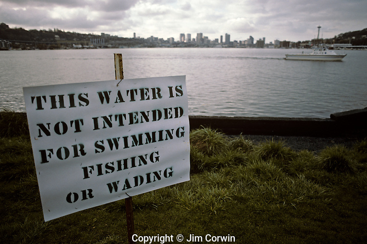 Warning sign at Gas Works Park along Lake Union concerning pollution in the water Seattle Washington State USA