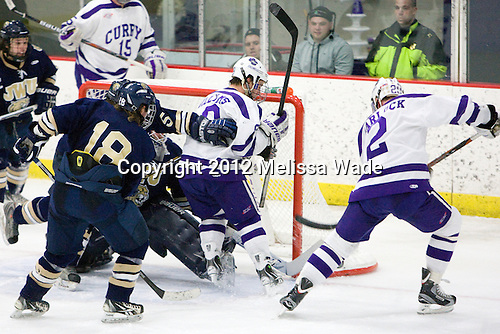 Ryan Barlock (Curry - 2) scores. - The Curry College Colonels defeated the Johnson & Wales University Wildcats 5-4 on Curry's senior night on Saturday, February 18, 2012, at Max Ulin Rink in Milton, Massachusetts.