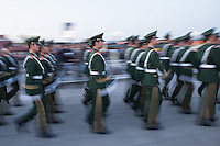 Chinese armies march after lowering the flag at the Tiananmen Square, Beijing.