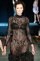 Model walks runway in a black dress, at the close of Slovak Fashion Night 2012 in New York City May 11, 2012.