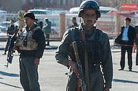 Afghan Police secure the area around the Interior Ministry in Kabul after a suicide bomber blew himself up at the gates of the building killing six of their colleagues. 2-4-14