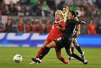 USWNT midfielder Carli Lloyd (10) challenges Kaylyn Kylie (6) Canada for the ball.....USWNT played to a 1-1 tie with Canada at LIVESTRONG Sporting Park, Kansas City, Kansas.
